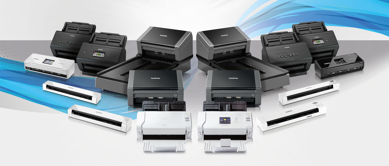 Black Brother document scanner on a desk next to pink file holder